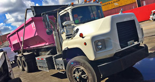truck for dumpster rentals in Miami, Florida